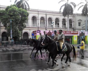 Picture of lucknow policemen patrolling on horseback at the Ganjing Carnival