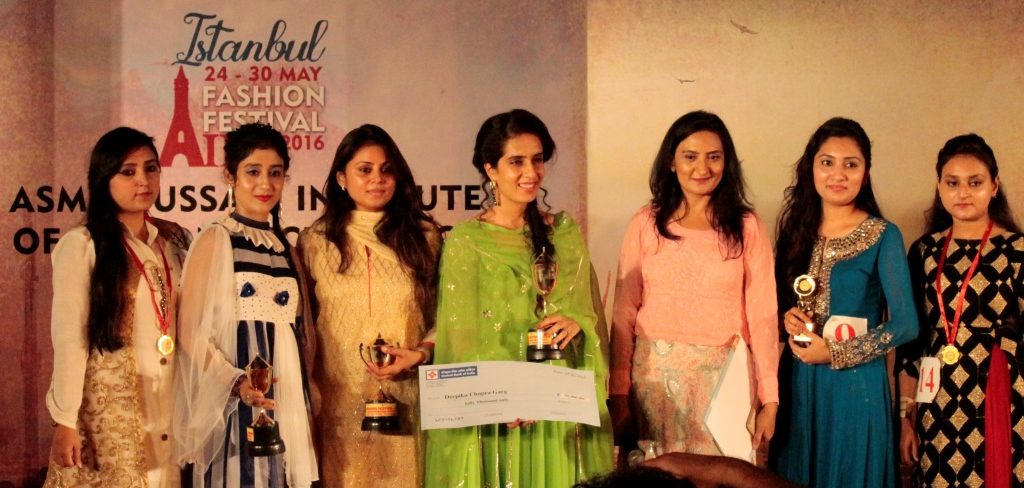 Picture has Asma Hussain with designers Deepika Chopra and Anju Narain with their models