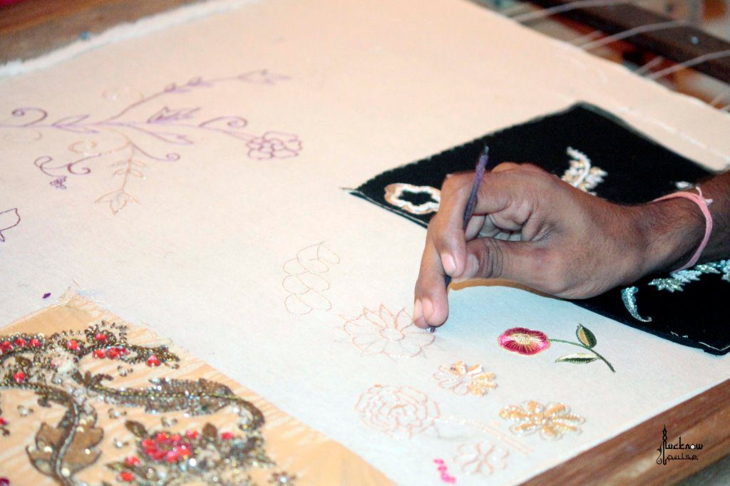 Picture of a Zardozi embroidery artisan (karigar) at work