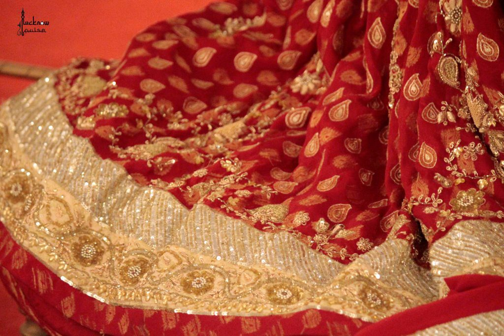 Picture of a maroon and golden lehnga with zardozi on brocade.