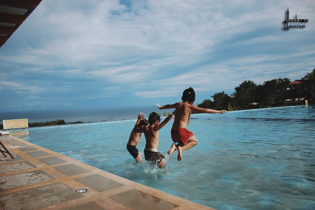 A pic showing kids jumping into a pool during summer vacations. Posted by Lucknowpulse.com